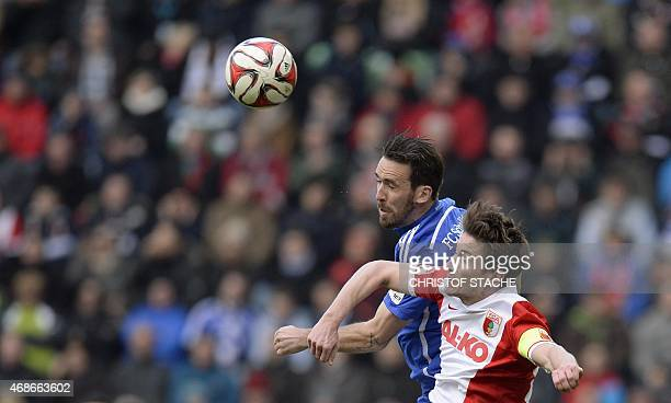 Augsburg's Dutch defender Paul Verhaegh and Schalke's Austrian defender Christian Fuchs vie for the ball during the German first division Bundesliga...