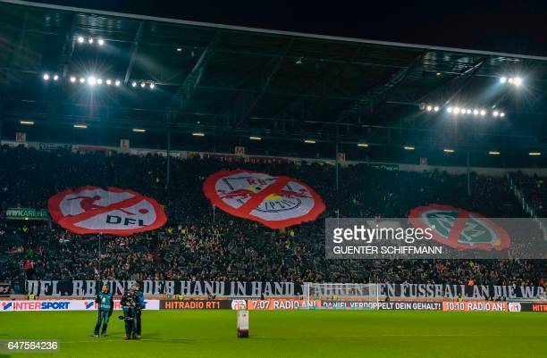 Augsburg's fans display an antiLeipzig banner during the German first division Bundesliga football match between FC Augsburg and RB Leipzig in...