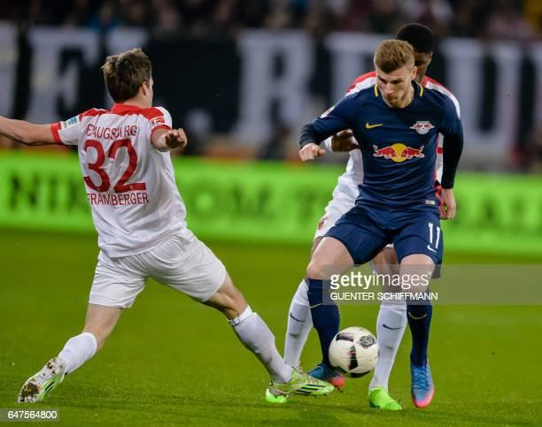 Augsburg's German defender Raphael Framberger and Leipzig's German striker Timo Werner vie for the ball during the German first division Bundesliga...