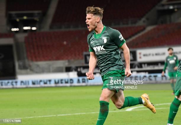 Augsburg's German forward Florian Niederlechner celebrates after scoring the 1-1 goal during the German first division Bundesliga football match VfB...