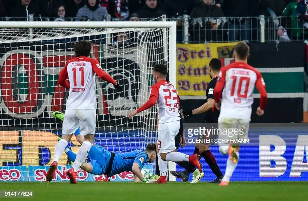 Augsburg's German forward Marco Richter scores the third goal during the German first division Bundesliga football match 1 FC Augsburg vs Eintracht...