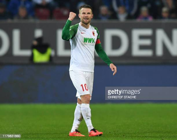 Augsburg's German midfielder Daniel Baier reacts after scoring the opening goal 1:0 for his team during the German first division Bundesliga football...