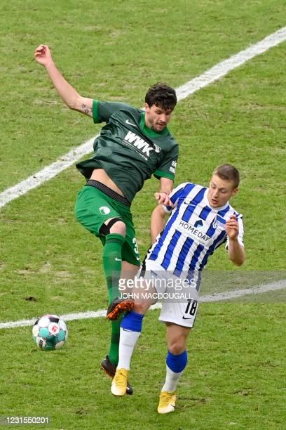 Augsburg's German midfielder Tobias Strobl and Augsburg's Slovak midfielder Laszlo Benes vie for the ball during the German first division Bundesliga...
