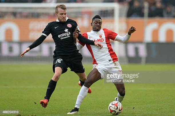 Augsburg's Ghanaian defender Abdul Rahman Baba and Mainz's defender Daniel Bengtsson vie for the ball during the German first division Bundesliga...