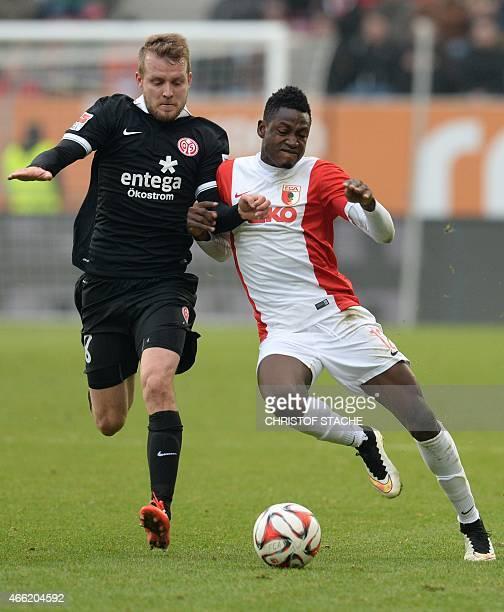 Augsburg's Ghanasian defender Abdul Rahman Baba and Mainz's defender Daniel Bengtsson vie for the ball during the German first division Bundesliga...