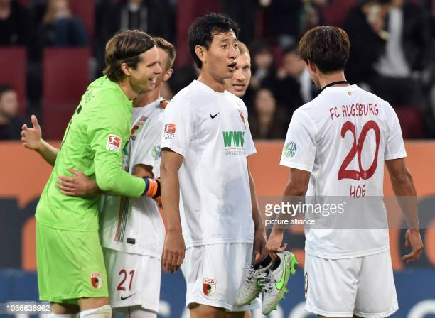Augsburg's goalkeeper Marwin Hitz celebrates with his teammates Dominik Kohr Ragnar Klavan Dong Wong Ji snd Jeong Ho Hong after the Bundesliga soccer...
