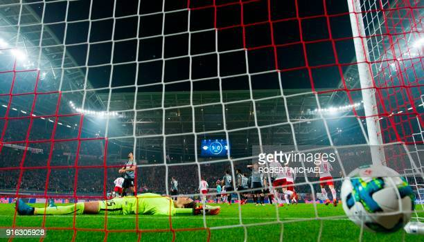 Augsburg´s goalkeeper Marwin Hitz lays on the field after Leipzig´s Guinean midfielder Naby Deco Keita scored the second goal during the German first...