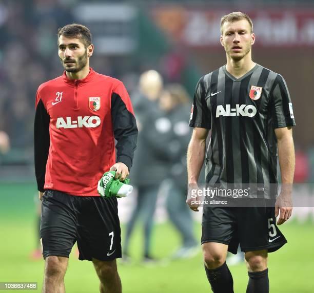Augsburg's Halil Altintop and Ragnar Klavan walk off the pitch after German Bundesliga soccer match between Werder Bremen and FCAugsburg at Weser...