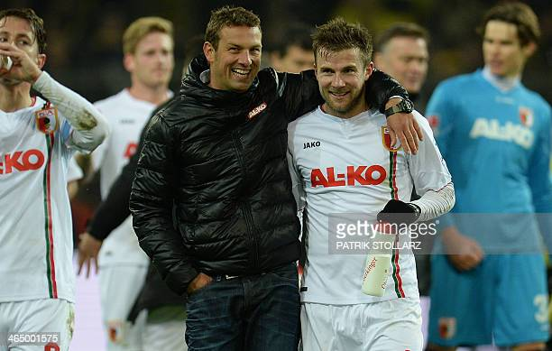 FC Augsburg's head coach Markus Weinzierl and FC Augsburg's midfielder Daniel Baier react during the German first division Bundesliga football match...