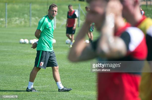 Augsburg's head coach Markus Weinzierl observes his players at the training camp of German Bundesliga soccer club FC Augsburg in Koessen Austria 20...