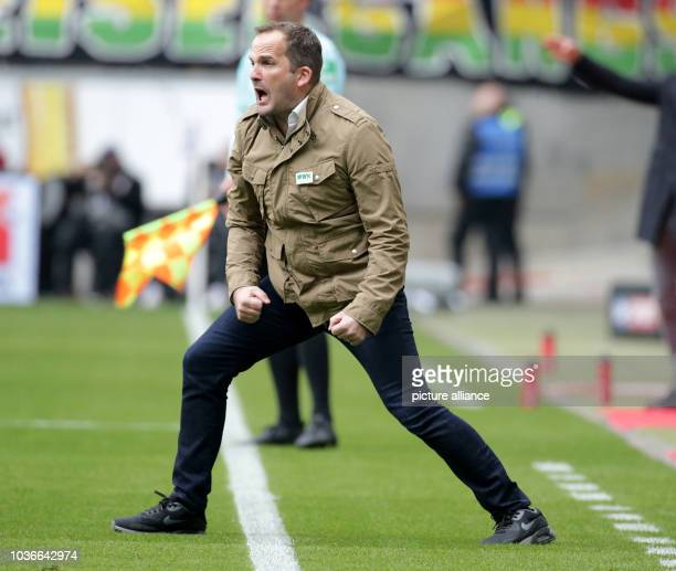 Augsburg's manager Manuel Baum gives instructions from the touchline during the German Bundesliga soccer match between Eintracht Frankfurt and FC...