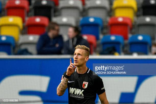 Augsburg's midfielder Andre Hahn celebrates after scoring during the German first division Bundesliga football match Fortuna Duesseldorf v FC...