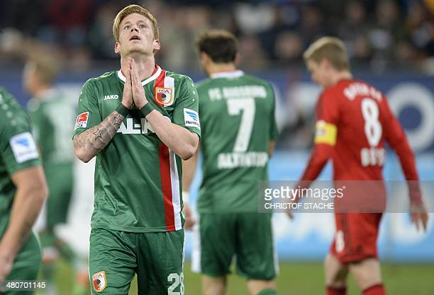 Augsburg's midfielder Andre Hahn reacts after a missed chance during the German first division Bundesliga football match FC Augsburg vs Bayer...