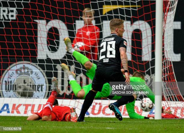 Augsburg's midfielder Andre Hahn scores during the German first division Bundesliga football match Fortuna Duesseldorf v FC Augsburg in Duesseldorf...