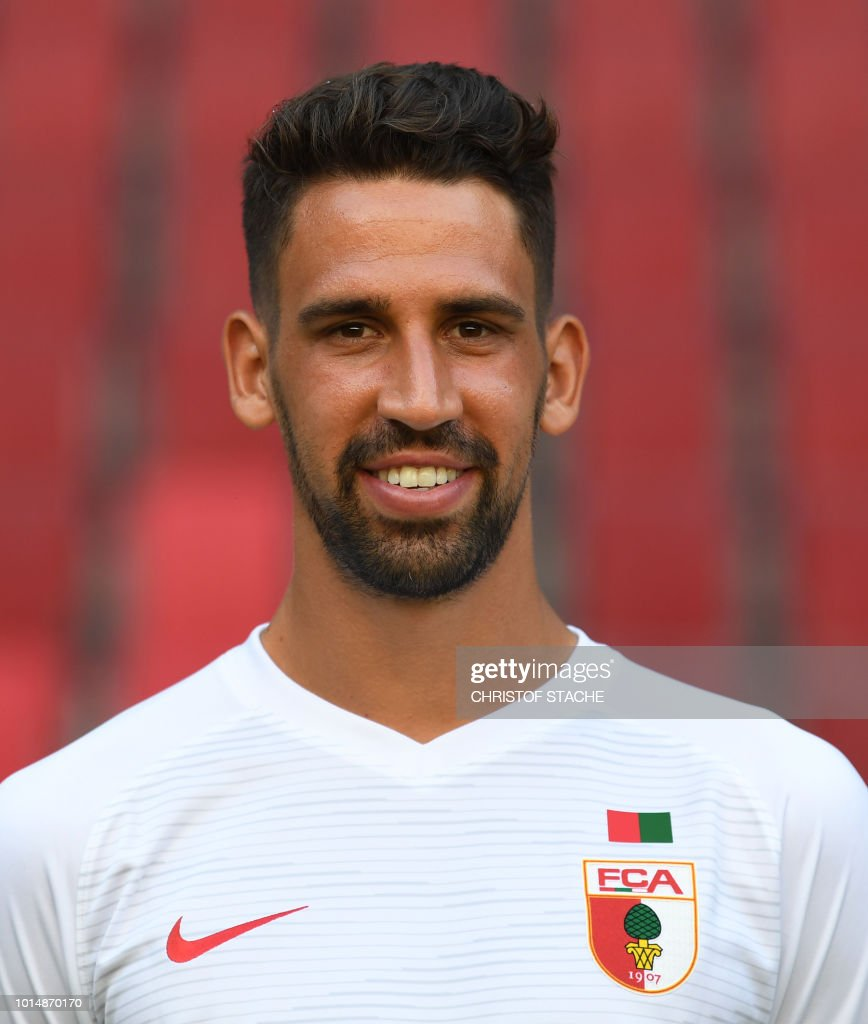 Augsburg's midfielder Rani Khedira poses during the presentation of the football team of the German first division Bundesliga club FC Augsburg 1907 in the stadium in Augsburg, southern Germany, on August 9, 2018.