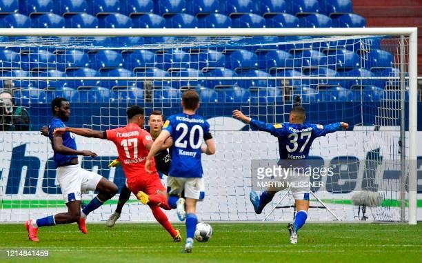 Augsburg's Nigerian midfielder Noah Sarenren Bazee scores his side's second goal during the German first division Bundesliga football match FC...