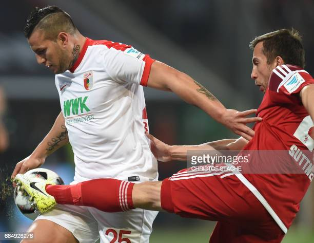 Augsburg's Paraguayan striker Raul Bobadilla and Ingolstadt's Austrian defender Markus Suttner vie for the ball during the German first division...