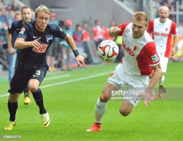 Augsburg's Ragnar Klavan and Berlin's Per Skjelbred fight for the ball during the Bundesliga Day 6 soccer match between FC Augsburg and Hertha BSC...