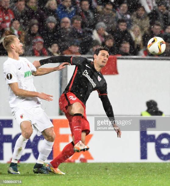 Augsburg's Ragnar Klavan and Bilbao's Aritz Aduriz vie for the ball during the UEFAEuropa League Group L soccer match between FC Augsburg and...
