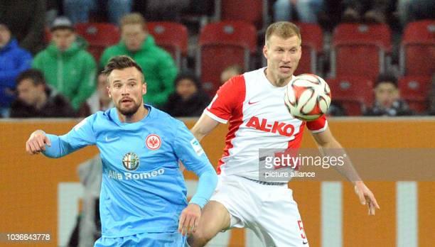 Augsburg's Ragnar Klavan and Frankfurt's Haris Seferovic vie for the ball at the German Bundesliga soccer match between FC Augsburg and Eintracht...