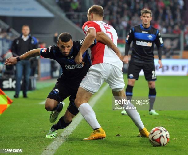 Augsburg's Ragnar Klavan and Paderborn's Suleyman Koc vie for the ball during the Bundesliga soccer match between FC Augsburg and SC Paderborn...