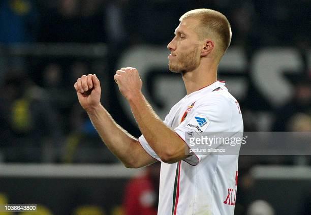Augsburg's Ragnar Klavan celebrates after the German Bundesliga soccer match between Borussia Dortmund and FC Augsburg at the SignalIdunaPark in...