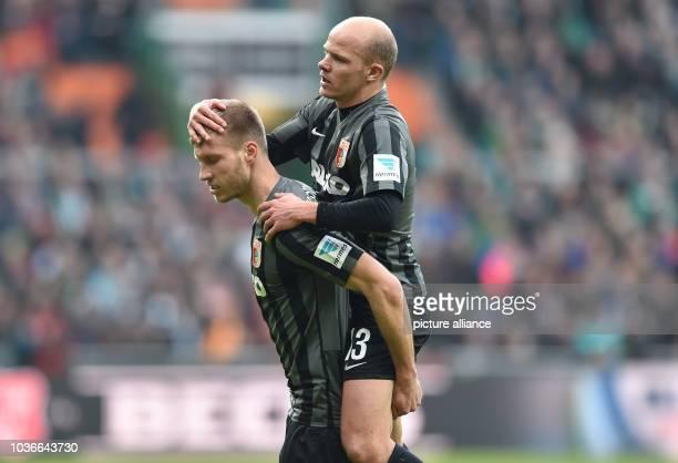 Augsburg's Ragnar Klavan celebrates his 11 goal with Tobias Werner during the German Bundesliga soccer match between Werder Bremen and FCAugsburg at...