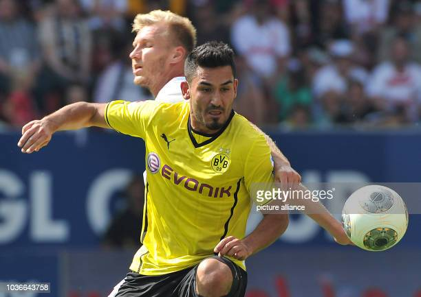Augsburg's Ragnar Klavan vies for the ball with Dortmund's Ilkay Gundogan during the Bundesliga soccer match between FC Augsburg and Borussia...