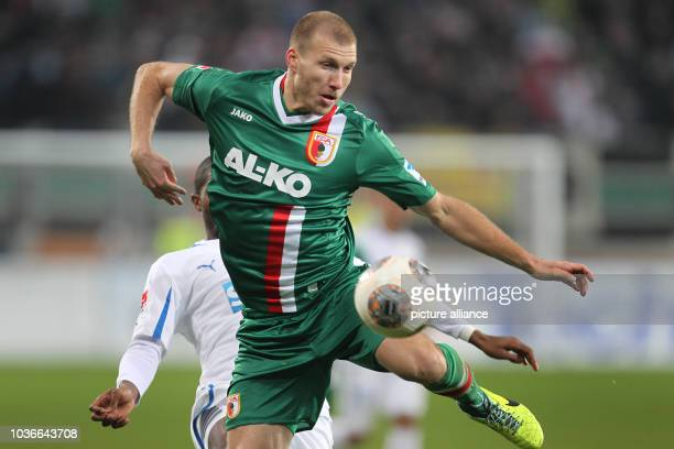 Augsburg's Ragnar Klavan vies for the ball with Hoffenheim's Anthony Modeste during the Bundesliga soccer match between FC Augsburg and 1899...