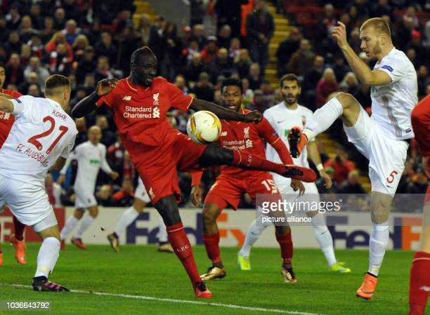 Augsburg's Ragnar Klavan vies for the ball with Liverpool's Mamadou Sakho during the UEFA Europa League round of 32 second leg soccer match between...
