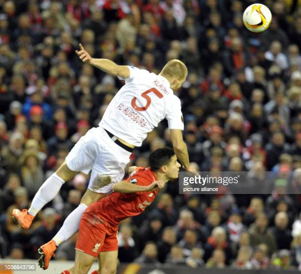 Augsburg's Ragnar Klavan vies for the ball with Liverpool's Philippe Coutinho during the UEFA Europa League round of 32 second leg soccer match...