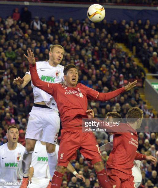 Augsburg's Ragnar Klavan vies for the ball with Liverpool's Roberto Firmino during the UEFA Europa League round of 32 second leg soccer match between...