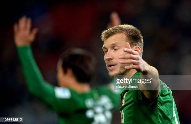 Augsburg's Raul Bobadilla and Ragnar Klavan lift their arms during the German Bundesliga soccer match between Hannover 96 and FC Augsburg at HDIArena...