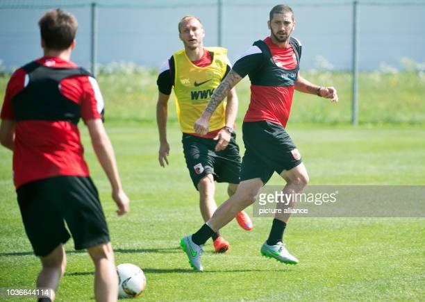 Augsburg's Sascha Moelders and Ragnar Klavan vie for the ball at the training camp of German Bundesliga soccer club FC Augsburg in Koessen Austria 20...