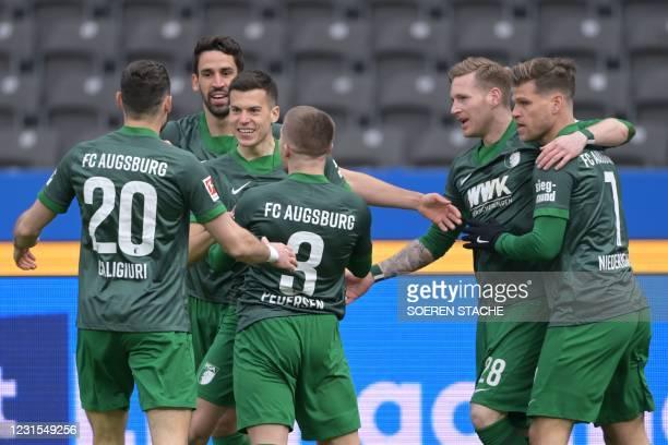 Augsburg's Slovak midfielder Laszlo Benes celebrates scoring the opening goal with teammates during the German first division Bundesliga football...