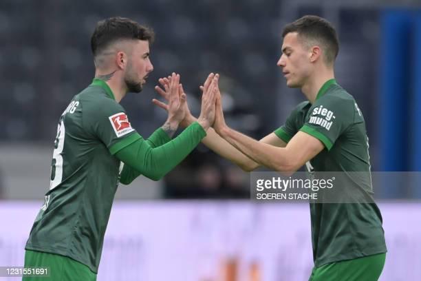 Augsburg's Slovak midfielder Laszlo Benes leaves the field for Augsburg's German midfielder Marco Richter during the German first division Bundesliga...