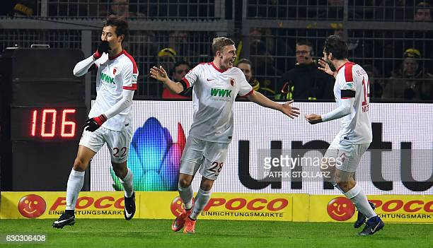 Augsburg's South Korean forward DongWon Ji Augsburg's Austrian midfielder Georg Teigl and Augsburg's Czech midfielder Jan Moravek celebrate after...