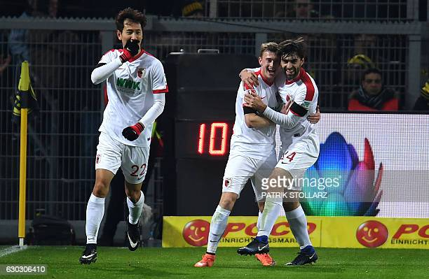 Augsburg's South Korean forward DongWon Ji Augsburg's Austrian midfielder Georg Teigl and Augsburg's Czech midfielder Jan Moravek celebrate after...