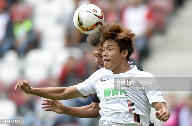 Augsburg's SouthKorean defender JeongHo Hong and Toulouse's Danish forward Martin Braithwaite vie for the ball during a friendly football match...