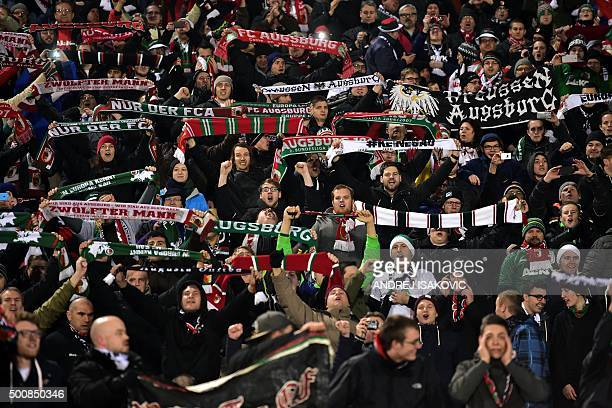 Augsburg's supporters celebrate their team's victory after the UEFA Europa League football match between FK Partizan and FC Augsburg at FK Partizan...