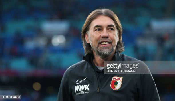 Augsburg's Swiss head coach Martin Schmidt enters the pitch prior to the German first division Bundesliga football match RB Leipzig v FC Augsburg in...