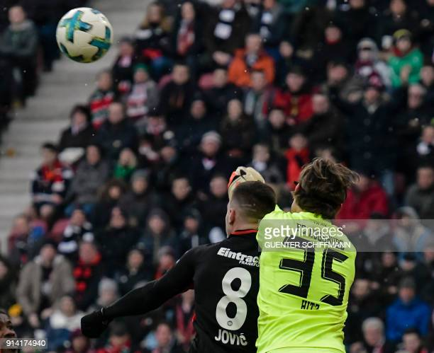 Augsburg's Swiss keeper Marwin Hitz and Frankfurt's Serbian forward Luka Jovic vie for the ball during the German first division Bundesliga football...