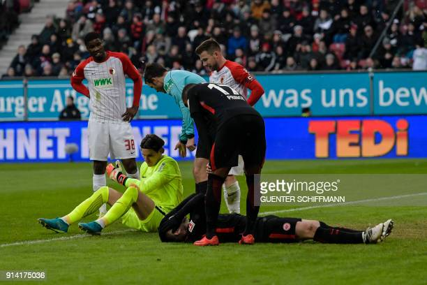 Augsburg's Swiss keeper Marwin Hitz and Frankfurt's Serbian forward Luka Jovic react on the pitch during the German first division Bundesliga...