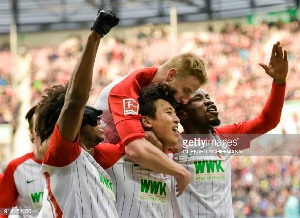 Augsburg's team celebrates scoring during the German first division Bundesliga football match 1 FC Augsburg vs Eintracht Frankfurt in Augsburg...