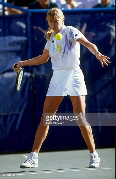 Steffi Graf of West Germany plays a forehand return during the US Open at Flushing Meadow in New York USA Mandatory Credit Rick Stewart/Allsport