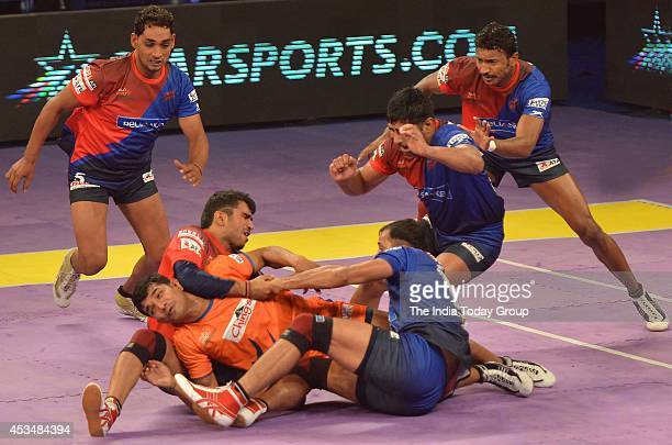 Kabaddi players of Bengal Warriors and Dabang Delhi in action during the match of ProKabaddi League in New Delhi