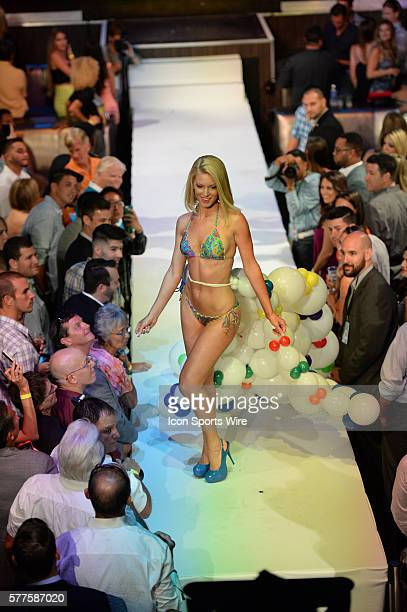 August 09 2014 The Miami Dolphins Cheerleaders' Swimsuit Fashion Show and Calendar Unveiling at the Fontainebleau in Miami Beach FL