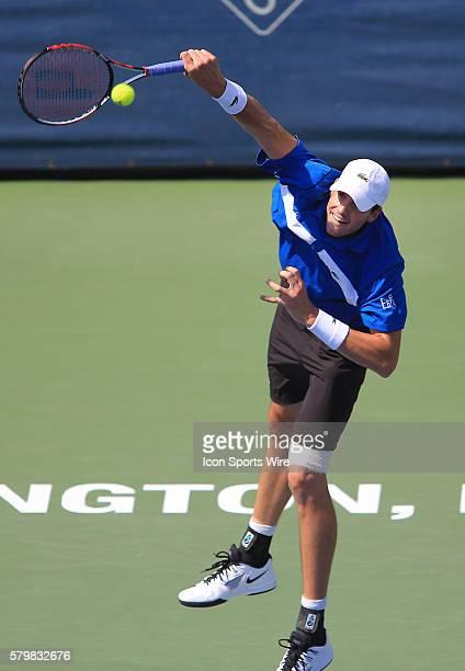 John Isner serves during the ATP men's singles final against Kei Nishikori at the CITI Open tennis tournament at the Rock Creek Tennis Center, in...