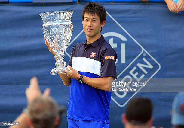 Kei Nishikori with the winners trophy after the ATP men's singles final against John Isner at the CITI Open tennis tournament at the Rock Creek...