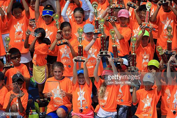 Local area children's teams honored before the ATP men's singles final between Kei Nishikori and John Isner at the CITI Open tennis tournament at the...